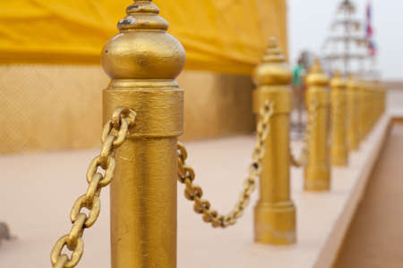 Pole and a chain to the next line. Surrounded in the pagoda. photo