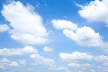 mergers: Clouds in sunny day clouds. Conglomerate mergers. And spread across the sky. Stock Photo