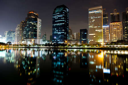 Tallest building in Bangkok, at night. There are various colors of light. Light reflected from the water front.