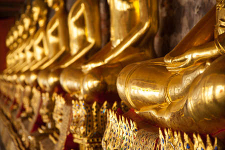 Buddha is a symbol of Buddhism. Long rows inside the temple. photo