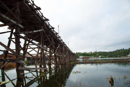 Wooden bridge across the river. The wood construction is to cross to the other side. photo