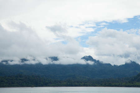 Sky, mountains and rivers. Natural scenery in the morning. Fog covered mountains. photo