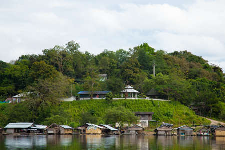 resort is next to a river. A resting place for travelers. Behind the mountains and trees. Stock Photo - 17614065