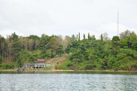 Riverside pavilion. A waterfront pavilion hills with dense tree cover. Stock Photo - 17614053