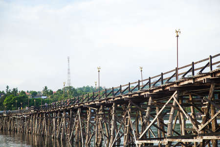 Wooden bridge across the river. Wooden bridge that spans the length of the second, Sangklaburi Kanchanaburi. photo