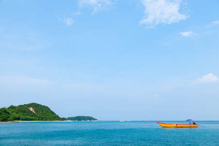 Beach and sea. The beaches of Koh Larn. Sand and sea with a ship moored in the calm sea. photo