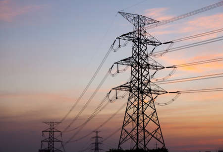 High voltage towers. High voltage power electric transmission towers of a power plant to the substation. photo