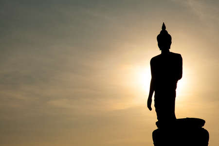 Larger Buddha. In the evening. The black silhouette of a Buddha statue. photo