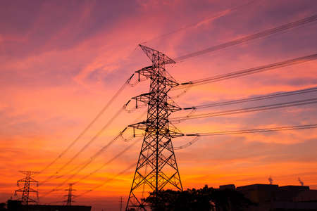 High voltage towers. The electric power industry and infrastructure. The sun is about to fall. Stock Photo