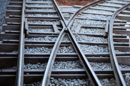 Railway tracks made of steel that is placed on a piece of wood. The stone floor was small.