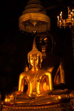 A large Buddha. Enshrined within the LDS. Thailands colorful and beautiful art.