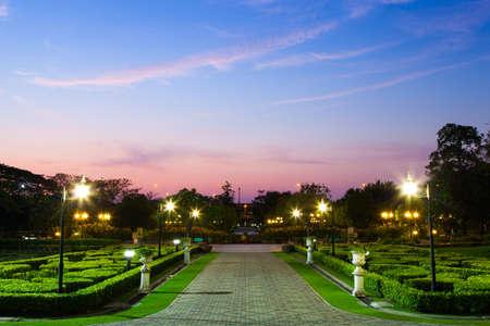 Park near dusk. Sky began to darken. Recessed Lighting in the garden is lit up.