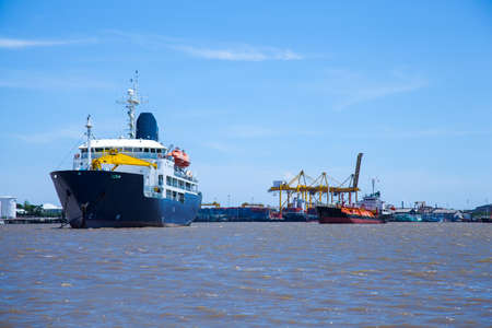 large cargo ship. Moored in the river. Space transportation industry.