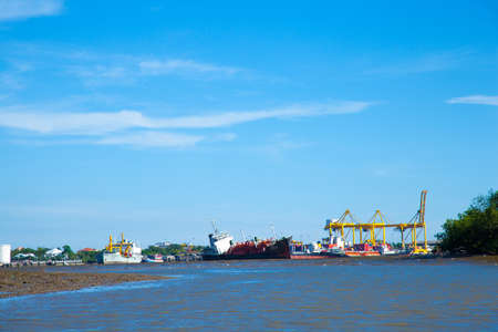 Many cargo ships. Large rivers. Harbor freight industry. Stock Photo