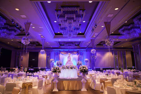 reception room: Marriage celebration with cake, banquet table. Flowers and decorations. Editorial