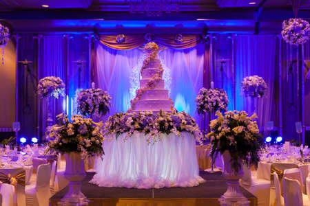 dinner hall: Marriage celebration with cake, banquet table. Flowers and decorations. Editorial