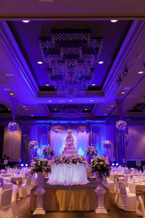 Marriage celebration with cake, banquet table. Flowers and decorations.