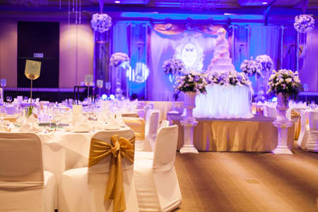 wedding reception: Marriage celebration with cake, banquet table. Flowers and decorations. Editorial