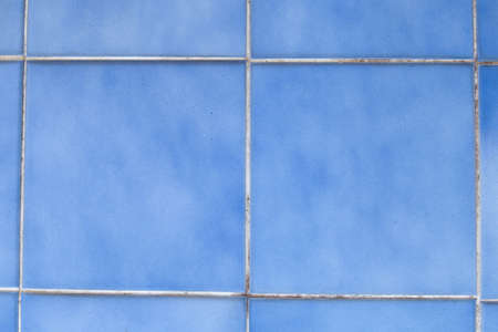 Blue wall tiles. A square with a groove between the sheets. photo