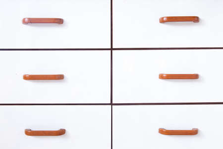Drawers with wooden handles. Drawer and drawer handles are made of white wood. photo