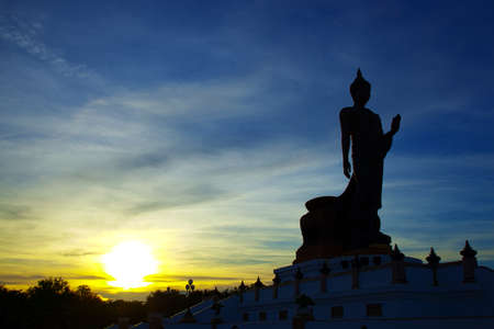 Silhouettes of the Big Buddha  In the evening at sunset near fall  Fresh dark sky  photo