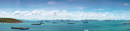 panorama cargo ship in sea.Cargo ships parked in the lot near the sea Island on Clear Cloud. photo
