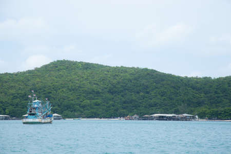 Large fishing boats. Float in the sea. Adjacent Villa Resort. photo