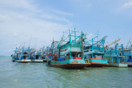 Fishing boats moored alongside the pier are a number of coastal areas. photo