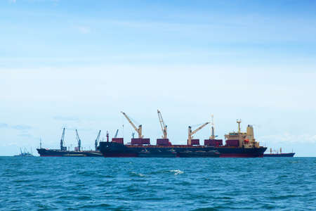 large cargo ship. Moored offshore. The import and export of goods waiting. photo