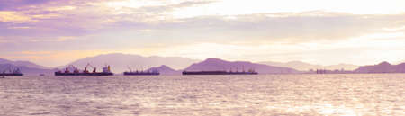 panorama cargo ship in sea at morning. photo
