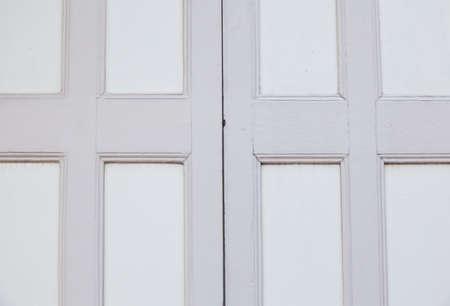 Old wooden door is the door hinge light gray. photo