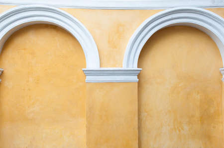 Wall arches. Corners of the door. The walls are painted in a classic brown.