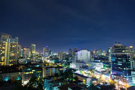Bangkok city at night. Skyscraper and buildings at night, turn on the lights. Atmosphere of the city at night, filled with light.