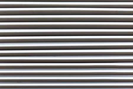 Louver window. Aluminum material as long as the background of the wall. Stock Photo - 23041030