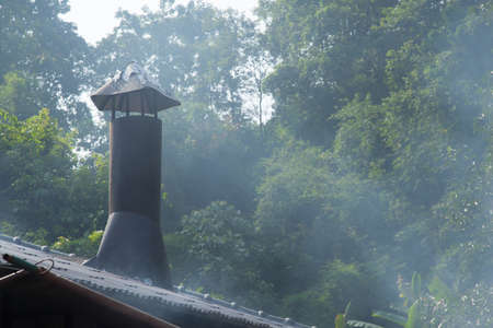 flue season: Smokestack with smoke from the kitchen out to the roof.