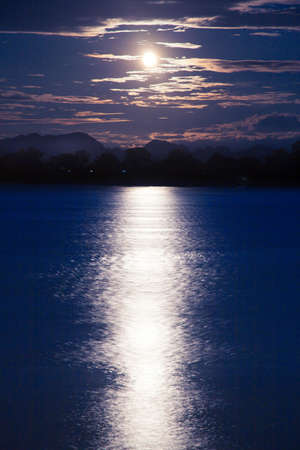 Full moon shining down on the river. A calm river at night. Stock Photo