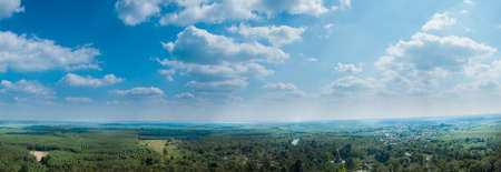 panorama sky cloud and forest.Forest and agricultural areas and the broader housing. Visible in wide angle