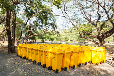 Yellow bins Many are located in the garden area. Cleaning photo