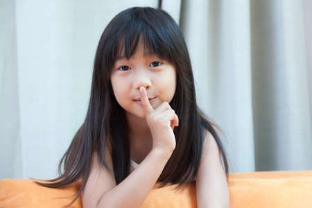 girl was silent. Asian kid with long black hair. photo