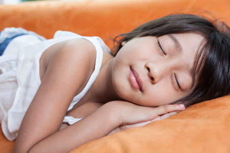 Girl was sleeping.child Asian women with long hair. Stock Photo