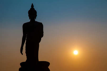 gradually: Big Buddha in the evening. The sun was about to fall Dark skies are gradually