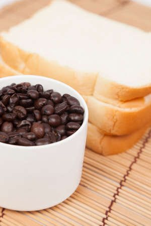 packshot: Bread plate and cup with coffee beans.on table wooden pack-shot in studio.