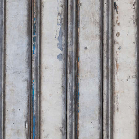 Wall of door aluminum. Old doors with signs of corrosion. photo