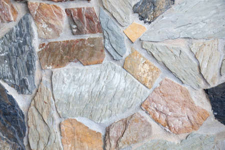 coming together: Stone wall background Various rock types and sizes coming together walls. Stock Photo