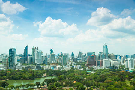 Bangkok city in day. In citys tallest building Area of the park. During the daytime the weather and clear. photo