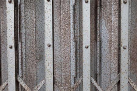 Door aluminum background. Old rusty stains on the door. photo