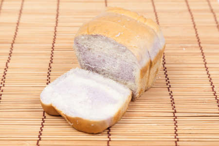 Sliced bread Placed on wood. Bread is cut into pieces evenly. photo