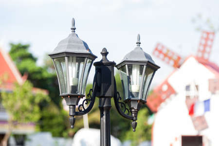 Black lamp. The lamp decoration in the garden. A pillar of fire-proof tube two lights. photo
