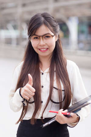Happy businesswoman hold document file and paper.smile and relax active businesswoman. photo