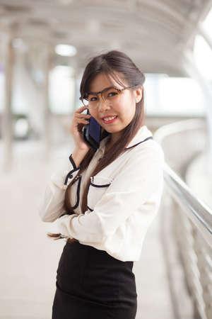 sidewalk talk: Smile businesswoman talking.Asian happy and smile businesswoman was talking phone.